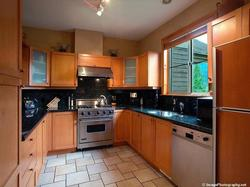 Full kitchen with quality stainless steel appliances, heated floors, fully equipped!