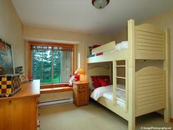 Upstairs bedroom with oversized twin bunk beds