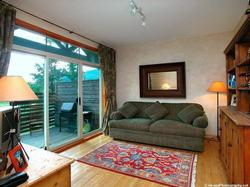 Family room with TV, VCR, large couch, fantastic views of lake & mountains