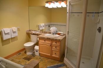 Spacious bathroom on main floor. Separate shower stall and jetted tub. Enter from hallway or master bedroom.