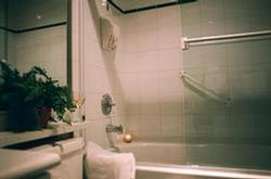 Inviting full tub and shower with sparking glass doors.. Nice heat lamp for when you get out!