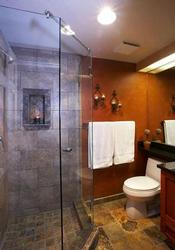Heated Travertine flooring. All new shower tiles and granite counter-top.