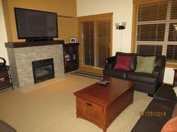 Cozy up to a warm fire with a good DVD or choose a free movie from Netflix on our 50 inch flat screen HD TV. Or play a video game on our Playstation 3 unit. 2nd Floor Living Room that adjoins Dining Area and Kitchen.