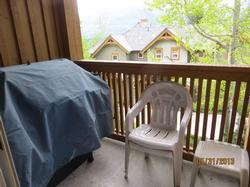 Balcony off of 2nd floor living/dining room with beautiful mountain views and a gas barbecue.