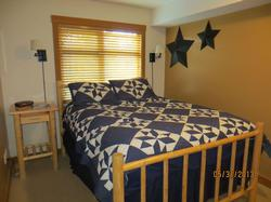 As you enter the foyer, 1st floor Queen bedroom with ensuite guest closet.