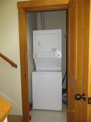 Full laundry washer dryer upstairs on staircase landing between 2nd and 3rd floor.