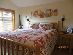 Large comfortable King size bed in the 3rd floor master bedroom.