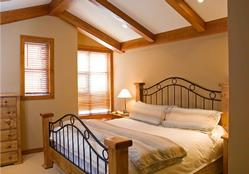 A luxurious king sized bed in the master bedroom for a good night's sleep after skiing.