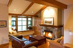 Imagine watching the snow fall from this huge window seat or sitting by the fire in the evenings after skiing!
