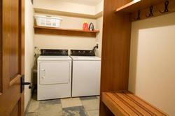 Laundry room with storage and bench for putting on your boots.