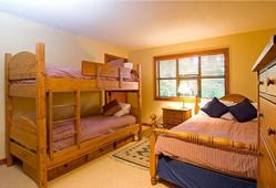 Family bedroom with one queen bed and bunk beds sleeps 4.