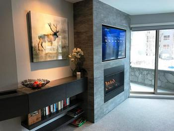 Remote controlled fireplace and inset wall mounted smart TV.