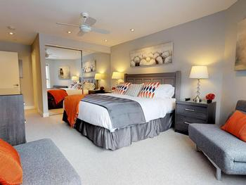 Master bedroom with en suite, spacious wardrobe and wall mounted Smart TV.