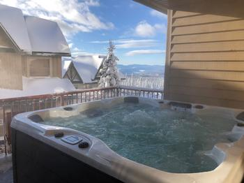 Soak and relax in the private hot tub with view over the monashee mountains