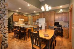 Fully equipped gourmet kitchen, with granite counters