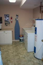 In-unit laundry room with full size washer and dryer; includes detergent and fabric softner available for your convenience.