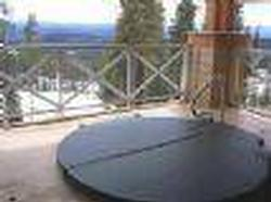 Hot tub --1 of 2 in the building for your use -- on separate covered decks with fabulous views of the ski run and Monashee mountains.