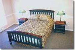 Master suite with queen size bed. Table with chairs. HUGE bedroom - 290 sq ft.