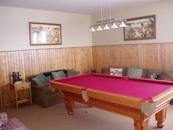 The games room has a solid pine pool table,T.V. with cable satalite and DVD/VCR player