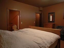 lower king bedroom comes equipped with a walk in closet, and direct access to the bathroom.