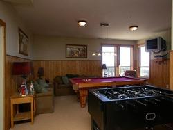 pool table television with DVD and CD capabilities foosball and assortment of games await you