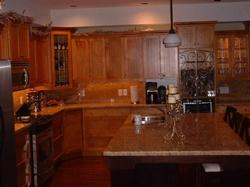 Tastefully designed kitchen w/bar stool counter and granite tops