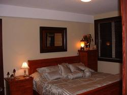 Both bedrooms feature private doors to deck hot tub and exotic wood sleigh beds furnished with Nasa mattress
