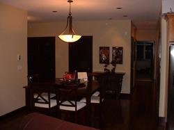 Raised formal Dining table area caters to picture window views by day and fine dining in the evening