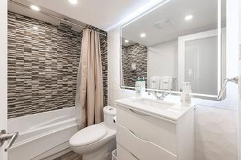 Bright modern bathroom, backlit mirror, rain shower!