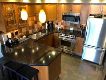 Gourmet kitchen with stainless steel appliances and plenty of equipment.
