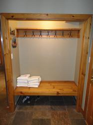Bench with plenty of coat hooks for storage