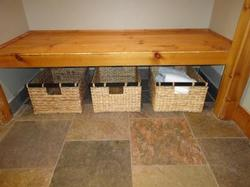 extra storage bins under entryway bench