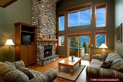 Great Room - Here you can relax by the fireplace and tell your stories. Soak in the Hot Tub just outside on the Patio and catch the weekly 8pm fireworks show.