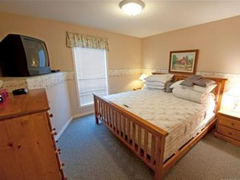 Master Bedroom has a comfortable King size bed, duvet, walk-in closet, and ensuite access to the bathroom. There is also a second TV to watch from the comfort of your bed.