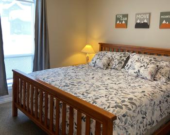 Master Bedroom has a comfortable King size bed, duvet, walk-in closet, and ensuite access to the bathroom. There is also a second brad new flat screen TV to watch from the comfort of your bed.