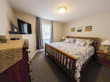 Spacious separate bedroom, with king-sized bed, chest-of-drawers and side tables. There is also a new flat screen TV to watch from the comfort of your bed.