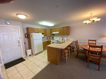 Fully equipped kitchen with large stove, microwave, full size refrigerator. There are also plenty of new pots and pans, crockery, cutlery and glassware.